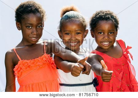 Threesome African Girls Doing Thumbs Up Together.