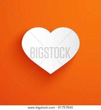 White paper heart on orange background