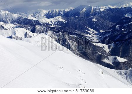 Off-piste Slope And Snowy Mountains