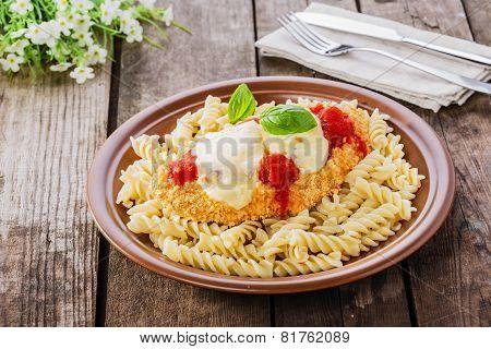 chicken schnitzel with tomato sauce and mozzarella parmesan