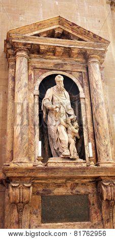 ITALY, FLORENCE- AUGUST 20, 2010: Statue in Duomo Santa Maria Del Fiore and Campanile.