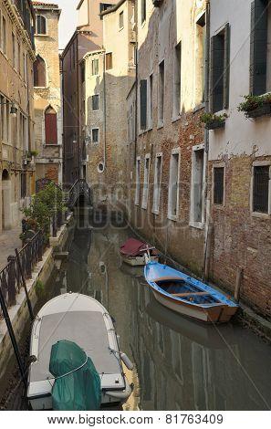 Boats Parked At A Narrow Canal