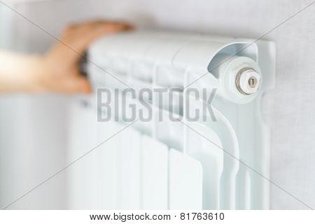 Arm Put On  Heating White Radiator.