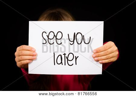 Child Holding See You Later Sign