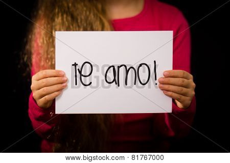 Child Holding Sign With Spanish Words Te Amo - I Love You