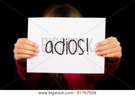 Child Holding Sign With Spanish Word Adios - Goodbye