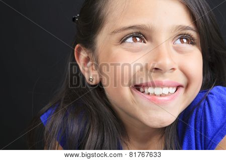 Columbian Little Girl Fun Look in front of a black background