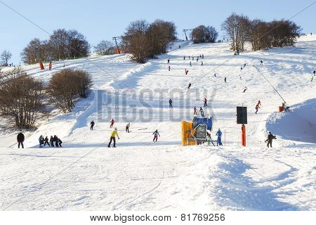 Downhill On Ski Slopes
