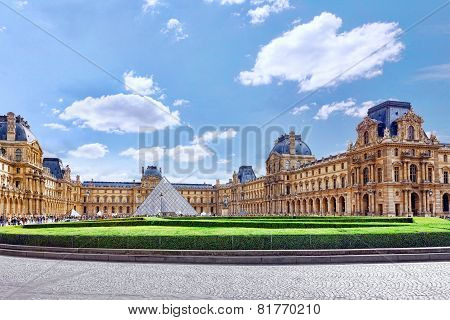 PARIS - SEPT 18: Glass Pyramid And The Louvre Museum On September, 18, 2013.