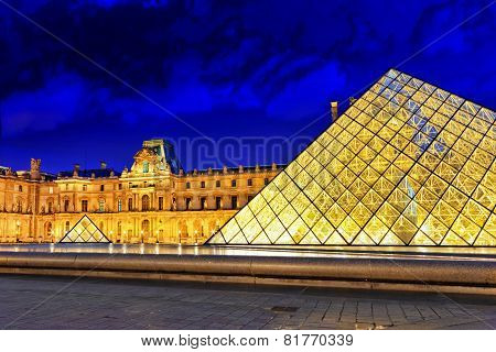 PARIS - SEPTEMBER 17. Glass Pyramid And The Louvre Museum On September, 17, 2013. The Louvre Is The