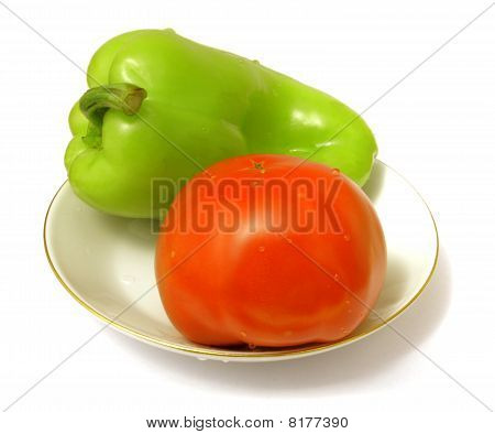 Tomato And Sweet Pepper On A Saucer