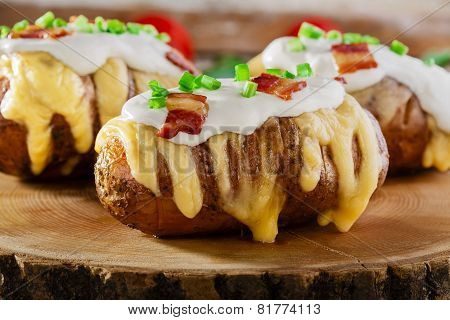 baked potato with cheese and sauce bacon
