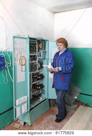 Engineer  Woman In Machine Room (elevator) .