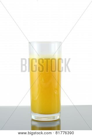 Glass Of Fresh Orange Juic? On  Grey  Background.