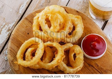 fried onion rings golden with red sauce