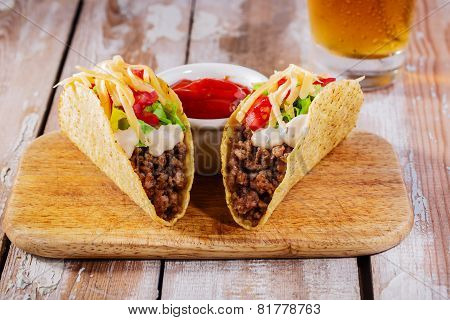 tacos with minced meat with cheese and tomatoes
