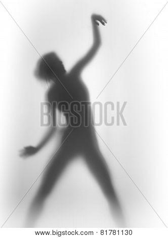 Beautiful slim woman dancing silhouette