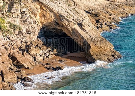 Small Grotto On Beach