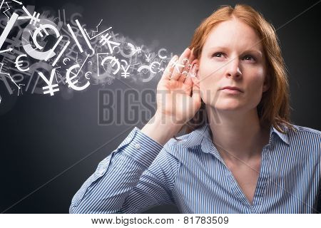Businesswoman Listens To Financial Data