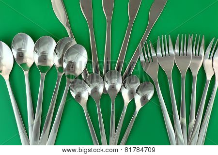 Table Serving-knife,spoon,fork On Green Backdrop.