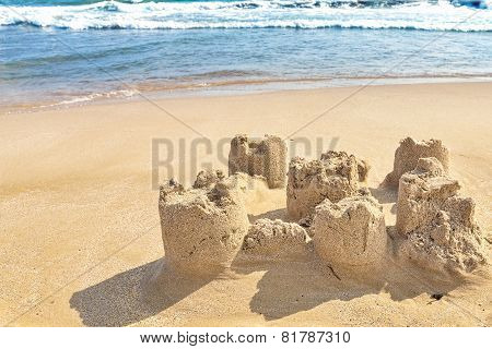 Destroyed sand castle on a beach.