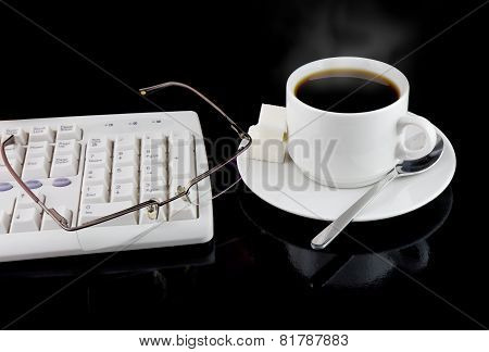 Cup Of Coffee, Keyboard On A Black.