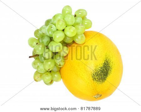 Ripe Melon With Green Grapes . Isolated