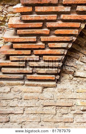 Collapsing Stone Wall Of An Old House With Brick Masonry