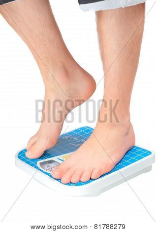 Man's Legs ,which Weighed On Floor Scale. Isolated