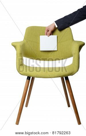 businessman hold white paper note on modern green armchair wooden leg isolated on white backgroundBusiness concept