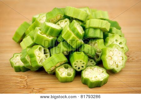 Pile Of Sliced Okra Bhindi Pieces On Rustic Wooden Background