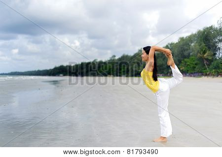 Beautiful Woman Yoga On The Beach