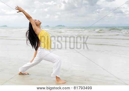 Beautiful Woman Yoga On The Beach.