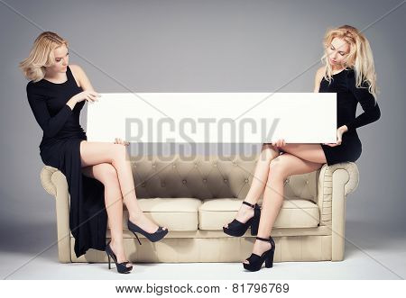 Two Girls Posing With Empty Board.