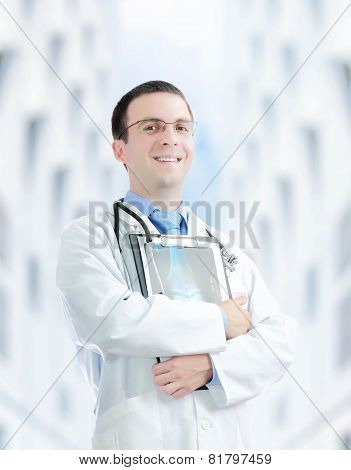 Doctor Stand Near The Hospital Main Entrance.