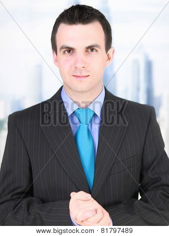 Portrait Of Cheerful Businessman In Black Suite.