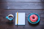 pic of donut  - donuts with notebook and pencil on the wooden pencil