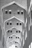 stock photo of qatar  - repeated arches in an old building in Doha  - JPG