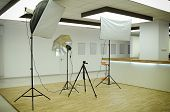 image of diffusion  - Indoor Photography Studio With Several Lighting Equipment - JPG