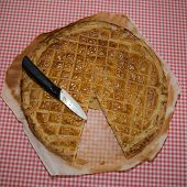 image of epiphany  - An epiphany cake on the table with a knife to cut it - JPG