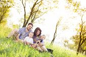 foto of father time  - Happy young family spending time together outside in green nature - JPG