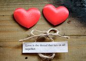 pic of two hearts  - A loving quote next to two love hearts and a tied string - JPG