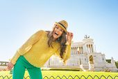 picture of piazza  - Portrait of happy young woman on piazza venezia in rome italy - JPG