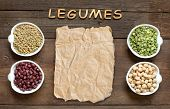 stock photo of legume  - Variety or legumes word Legumes and paper on a wooden table - JPG