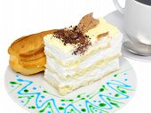 pic of eclairs  - Sponge cakes and eclair cake on plate with fruit juice spots - JPG