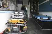 stock photo of stretcher  - The Inside of a paramedic ambulance with stretcher on it - JPG