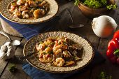 stock photo of shrimp  - Homemade Shrimp and Sausage Cajun Gumbo Over Rice - JPG