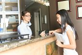 foto of receptionist  - A dental assistance receptionist appointment at the dentist office - JPG