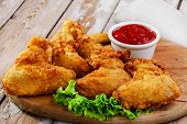 picture of chicken wings  - fried chicken wings in batter on the board - JPG