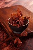 foto of meats  - Beef jerky. Dried meat beef jerky on wooden chopping board on wooden background. Dry meat rustic country style. Delicious meat eating.